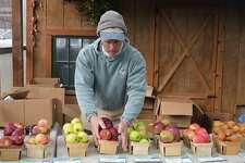Pete Teveris of Woodland Farm in South Glastonbury displays apples at the wintertime Westport Farmer's Market, Saturday, Jan. 12, 2019, in Westport, Conn.