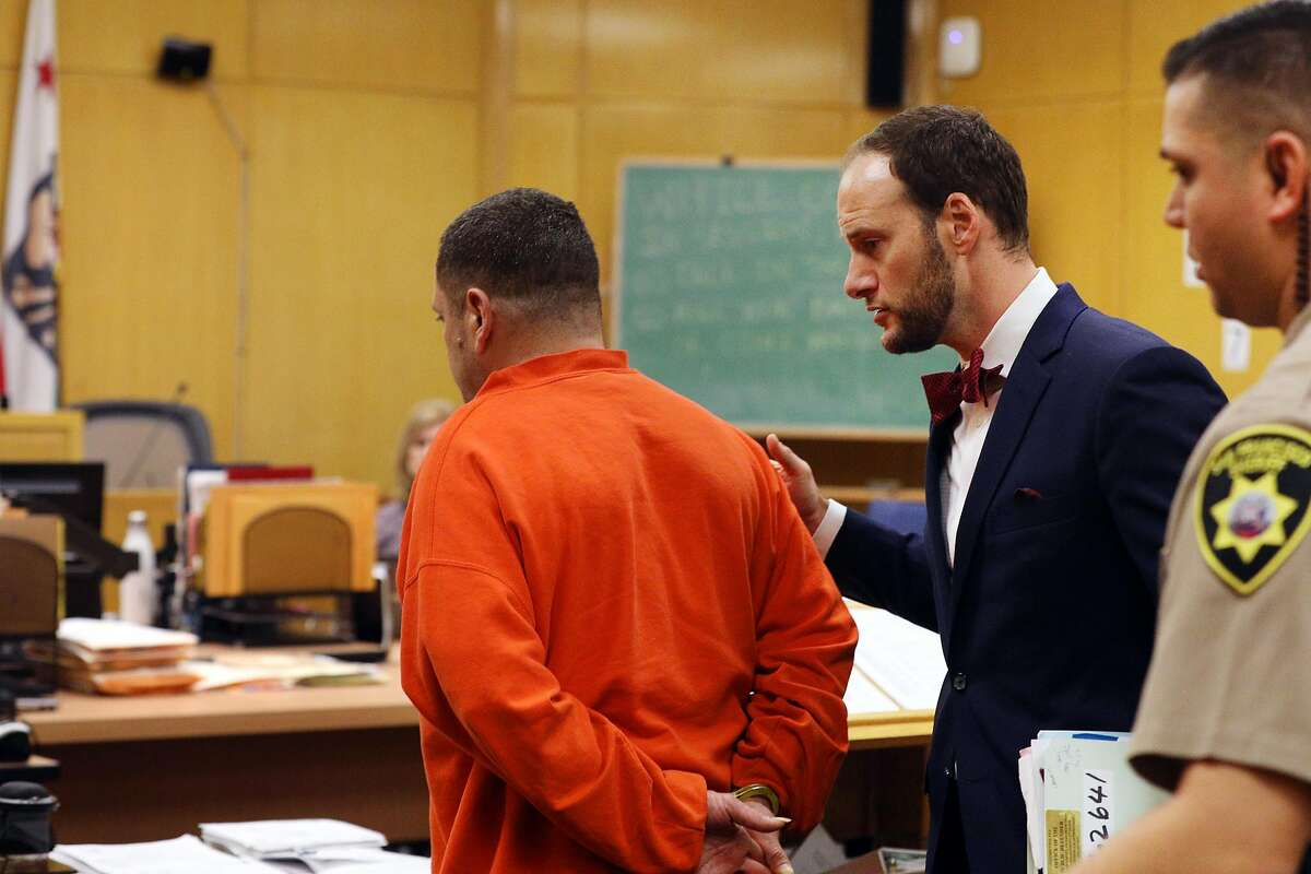 Deputy Public Defender Chesa Boudin (center) speaks to client at a pretrial conference in Judge Christopher Hite's courtroom in Department 23 at the Hall of Justice on Monday, January 14, 2019 in San Francisco, Calif.