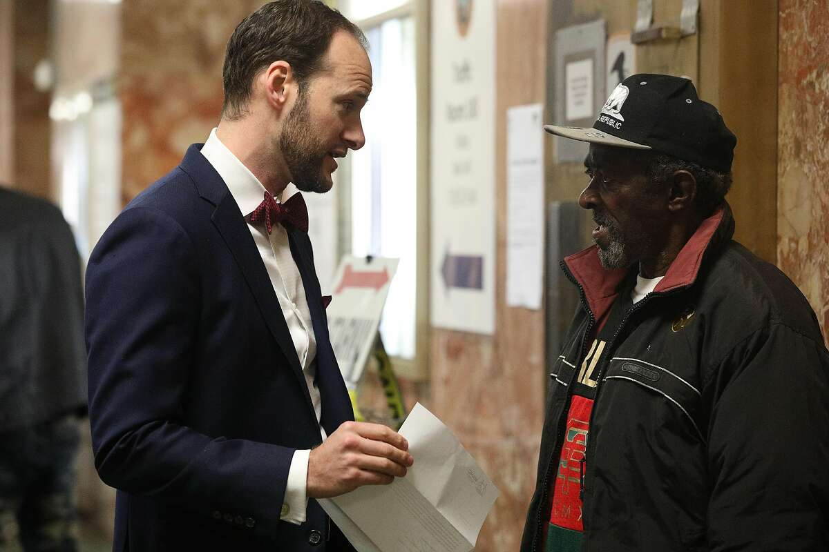 Deputy Public Defender Chesa Boudin (l to r) speaks with a client in the hallway at the Hall of Justice on Monday, January 14, 2019 in San Francisco, Calif.