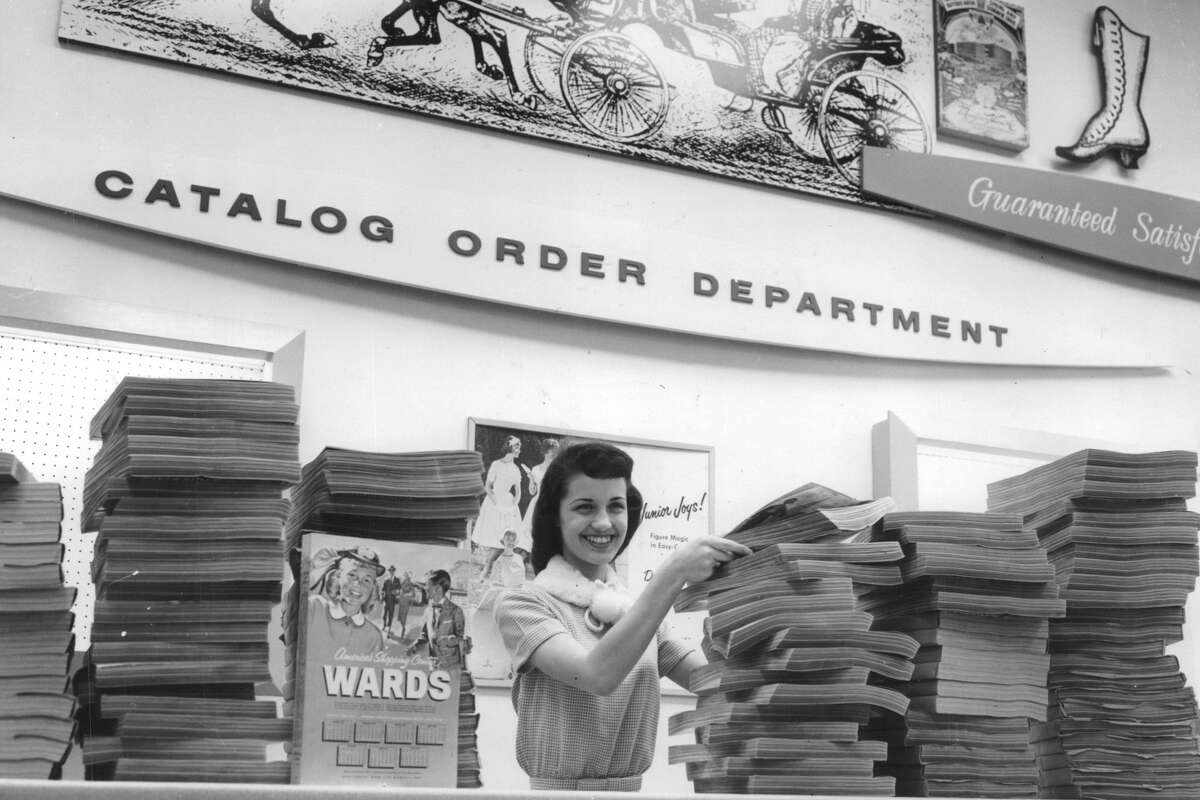 From the April 15, 1959, Houston Chronicle: Pretty Miss Shirley Whittemore, employee of the $2,500,000 Montgomery Ward & Co. store at Griggs Rd and South Park Blvd. poses behind a stack of Ward catalogs. This department is the biggest of its kind in Texas and the books contain lists of 100,000 items which can be purchased at Ward's.