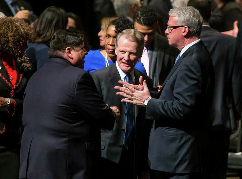 Illinois Speaker of the House Michael Madigan, D-Chicago, visits with Illinois House Minority Leader Jim Durkin, R-Western Springs, and Illinois Gov.-elect J.B. Pritzker prior to to the inauguration ceremony for the Illinois House of Representatives for the 101st General Assembly at the University of Illinois Springfield's Sangamon Auditorium, Wednesday, Jan. 9, 2019, in Springfield, Ill.