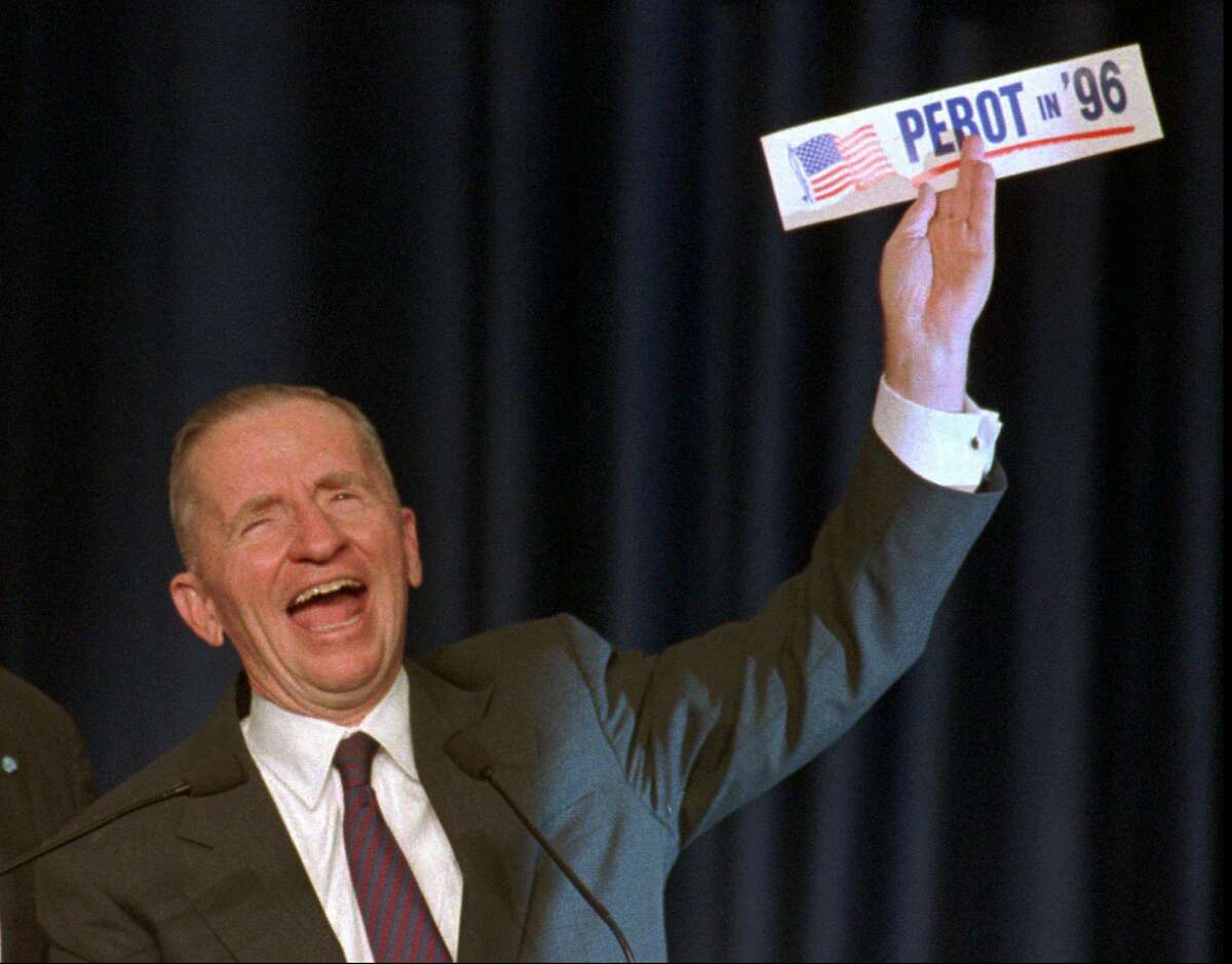 H. Ross Perot holds up a 'Perot in '96' bumper sticker on election night in Dallas, in Nov.1992. Perot ran for president in 1992 as an independent and in 1996 as a member of the Reform Party.