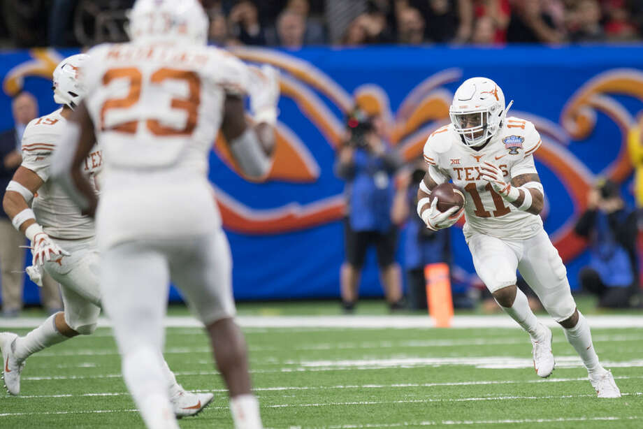 PJ Locke looks for open space after an interception in the Allstate Sugar Bowl against Georgia. Photo: Texas Athletics