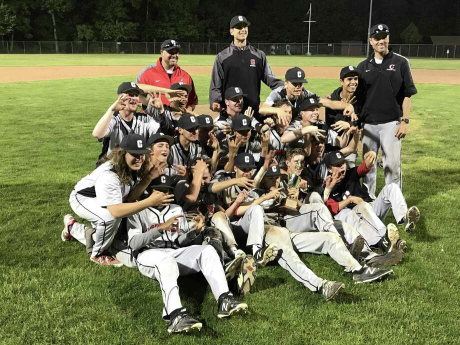 Members of the Cromwell baseball team celebrate their win in Friday's Shoreline Championship game. Photo: Hearst Connecticut Media File Photo