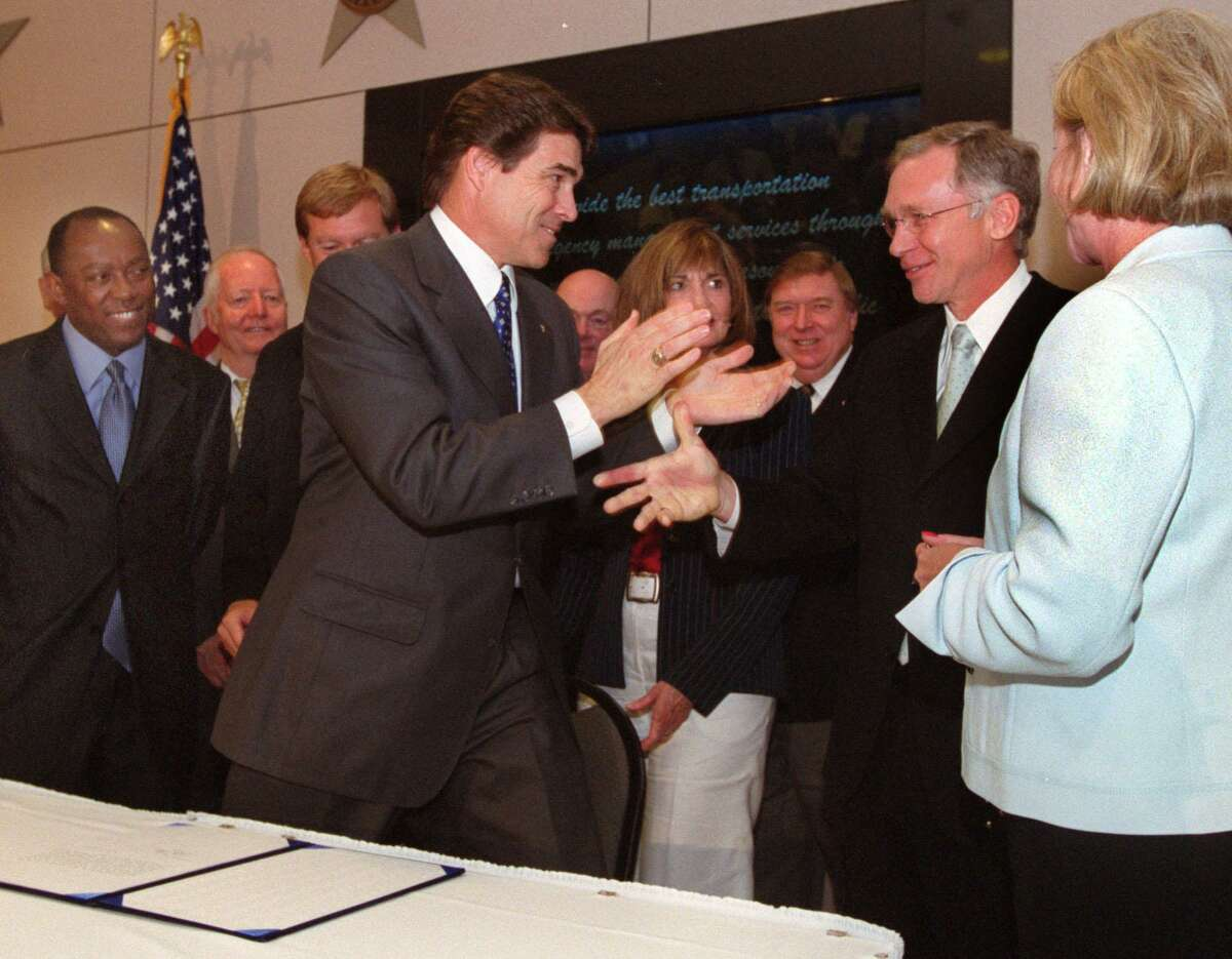 In 2003, Gov. Rick Perry claps for Dr. Guy Clifton, acknowledging his hard work to help create the Texas Driver Responsibility Program to provide money for the state's trauma care centers. That was then. Today, the program is an abject failure.