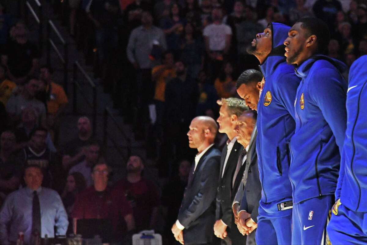 DENVER, CO - OCTOBER 21: Kevin Durant #35 of the Golden State Warriors stands for the National Anthem before the game against the Denver Nuggets at Pepsi Center on October 21, 2018 in Denver, Colorado.