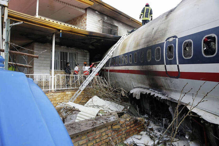 A picture taken on January 14, 2019 shows a Boeing 707 cargo plane that reportedly crashed into a residential complex near the Iranian capital Tehran with at least 10 people onboard. - The plane overshot the runway during its landing, Iran's aviation organisation spokesman Reza Jafarzadeh told state broadcaster IRIB. Photo: HASAN SHIRVANI/AFP/Getty Images