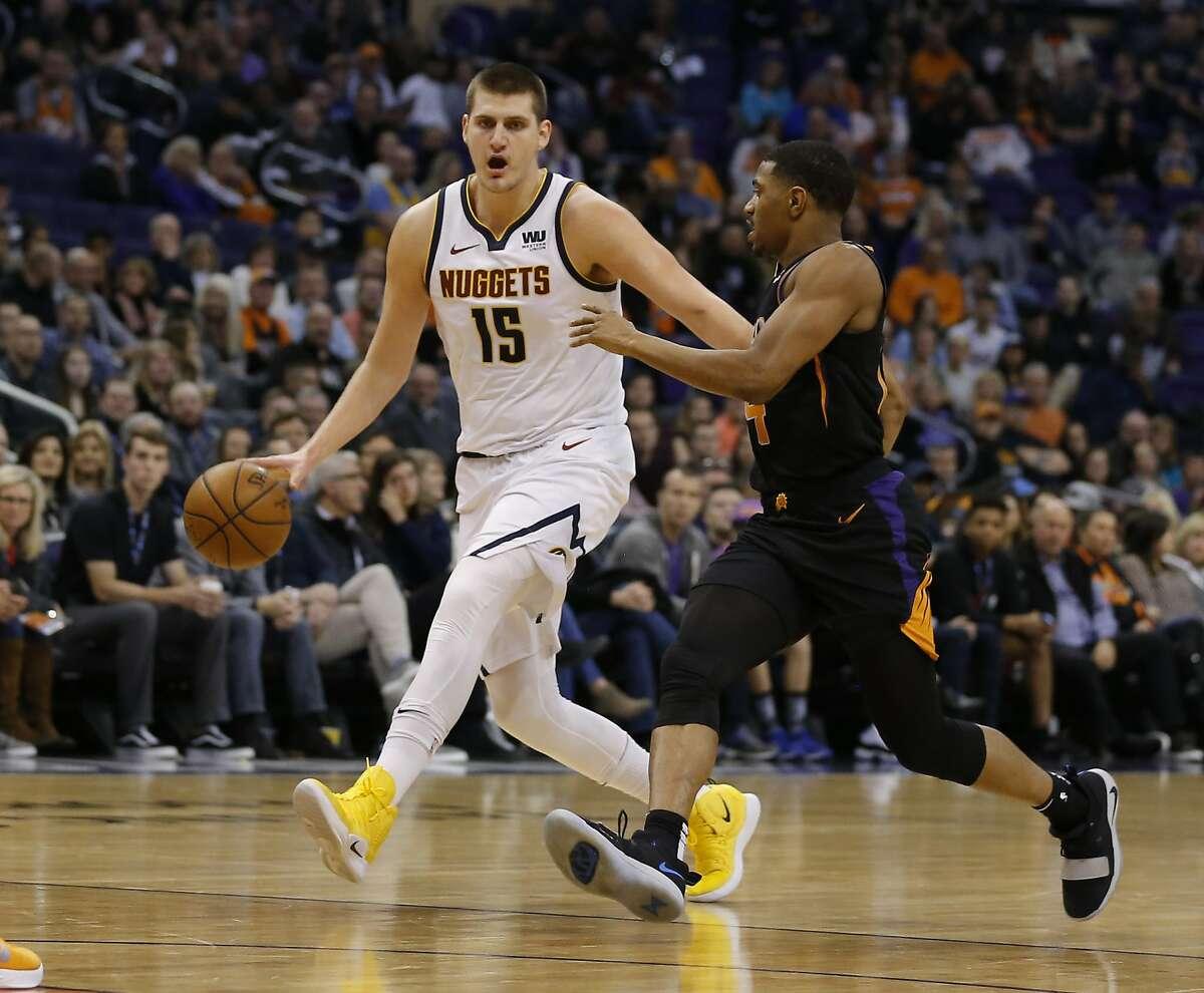 Denver Nuggets center Nikola Jokic (15) in the first half during an NBA basketball game against the Phoenix Suns, Saturday, Jan. 12, 2019, in Phoenix. (AP Photo/Rick Scuteri)