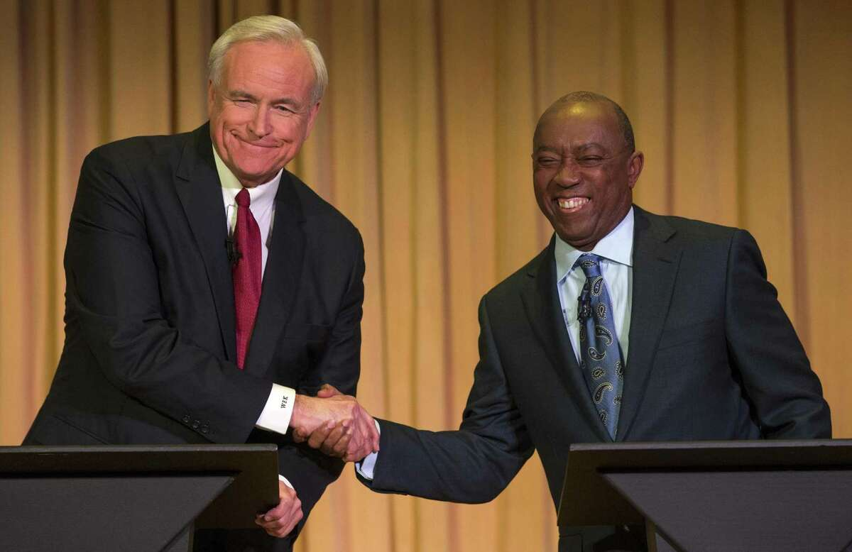 Bill King, at left during December 2015 mayoral debate with Sylvester Turner, announced plans Monday to launch a petition drive to amend Houston's charter to bar political donors from doing business with the city for up to two years. ( Brett Coomer / Houston Chronicle )