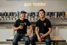 Tim Luym (left) and Gore Song of the Brew Coop.