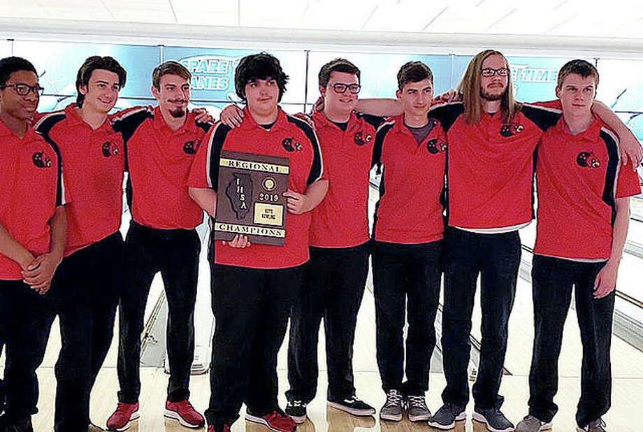 The Alton High boys bowling team captured its third consecutive regional championship Monday in Decatur and will advance to its own sectional tournament next Saturday at Bowl Haven. From left are T'ravion Ward, Lance Perkey, Jared Cochran, Trevor Vallow, Chris Duke, Dan Laslie Jr, Gavin Taylor and Matt Engdale. Photo: Submitted Photo