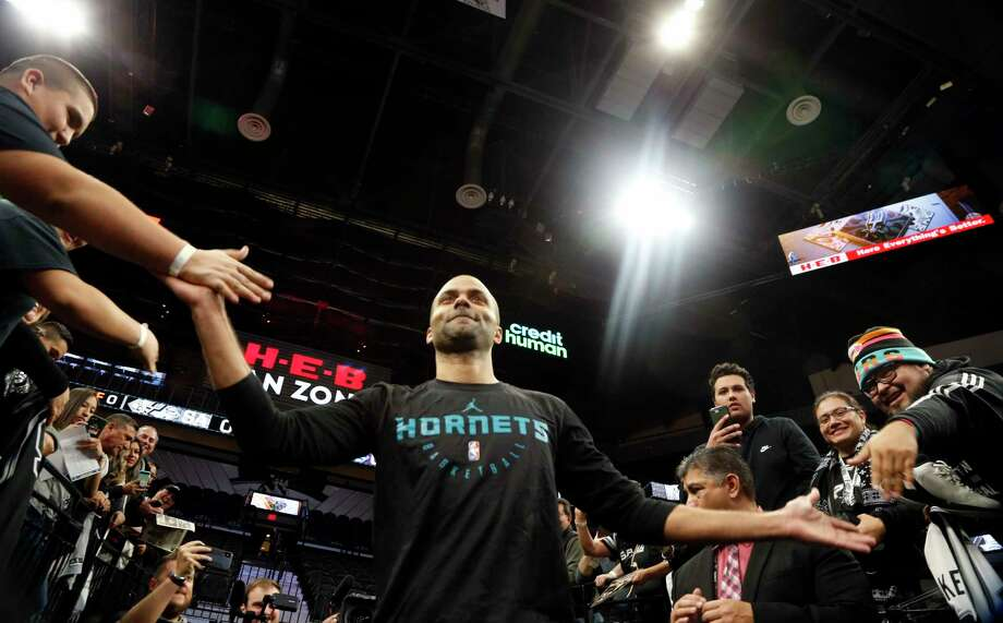 Tony Parker #9 of the Charlotte Hornets high fives fans as he enters the court on Monday, January 14, 2019 at AT&T Center. / 2019 Ronald Cortes