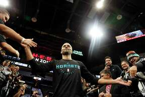 Tony Parker #9 of the Charlotte Hornets high fives fans as he enters the court on Monday, January 14, 2019 at AT&T Center.