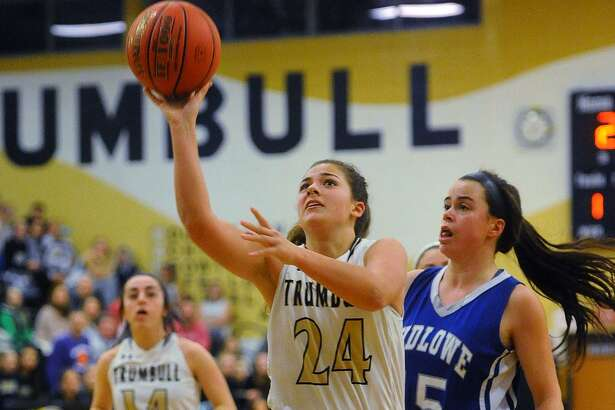 Trumbull's Cassi Barbato drives to the basket defended by Ludlowe's Bridget Paulmann in Monday night's game at Trumbull High School.