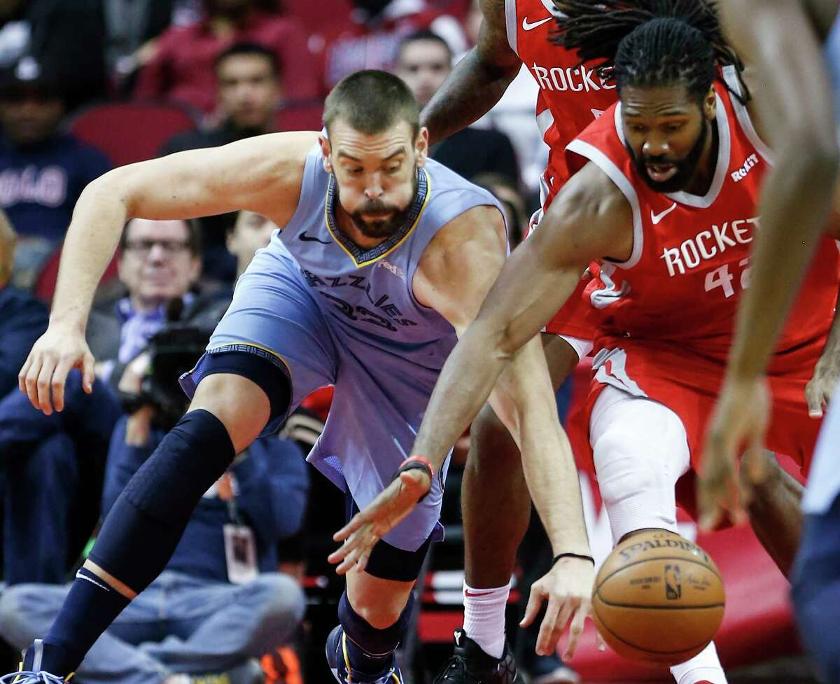 Memphis Grizzlies center Marc Gasol (33) and Houston Rockets center Nene (42) go after a loosew ball during the first half of an NBA basketball game at Toyota Center on Monday, Jan. 14, 2019, in Houston.