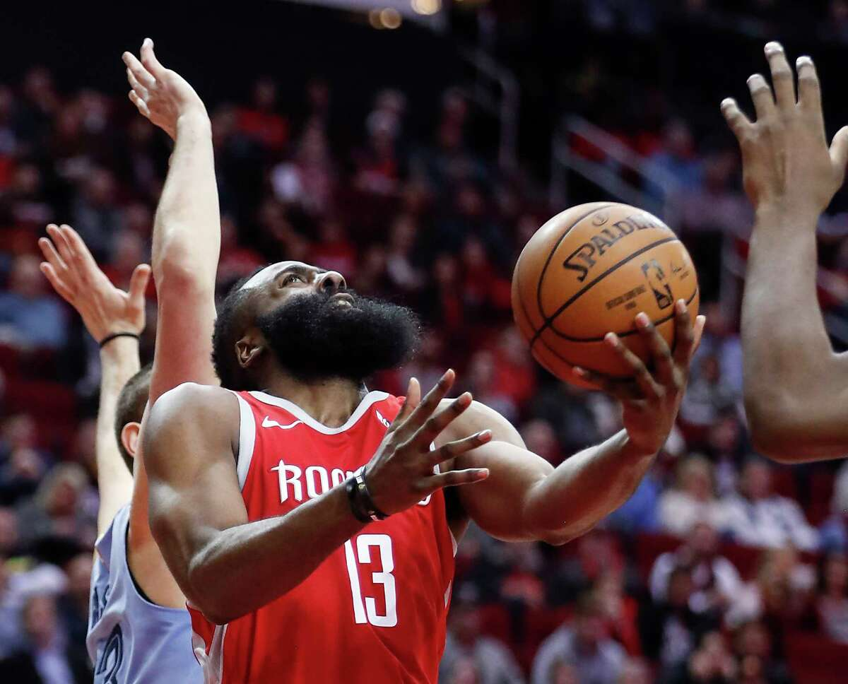 Houston Rockets guard James Harden (13) shoots a backward layup against the Memphis Grizzlies during the first half of an NBA basketball game at Toyota Center on Monday, Jan. 14, 2019, in Houston.