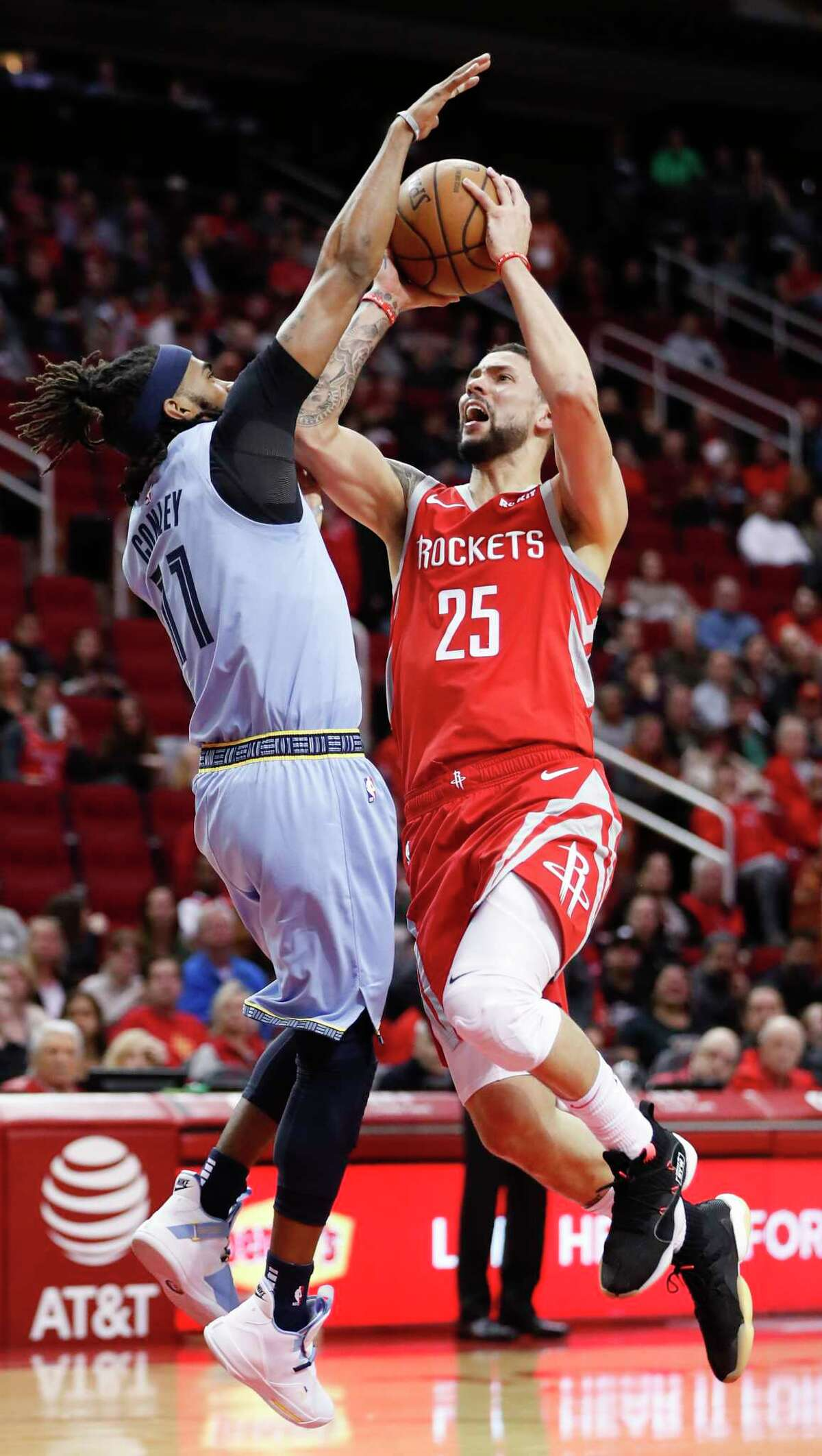 Houston Rockets guard Austin Rivers (25) goes up against Memphis Grizzlies guard Mike Conley (11) as he shoots during the first half of an NBA basketball game at Toyota Center on Monday, Jan. 14, 2019, in Houston.