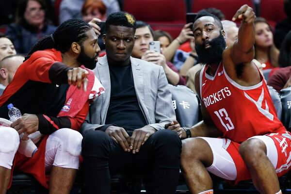 Houston Rockets center Nene, left, center Clint Capela (15) and guard James Harden (13) talk on the bench during the first half of an NBA basketball game against the Memphis Grizzlies at Toyota Center on Monday, Jan. 14, 2019, in Houston. Capela did not suit up for the game.