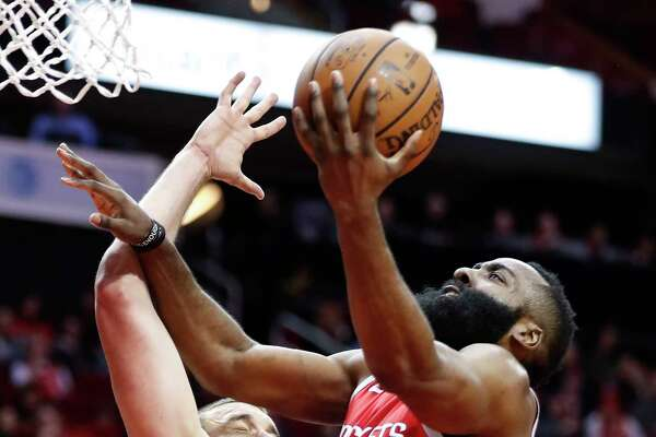 Houston Rockets guard James Harden (13) takes the ball in for a layup past Memphis Grizzlies center Marc Gasol (33) during the first half of an NBA basketball game at Toyota Center on Monday, Jan. 14, 2019, in Houston.