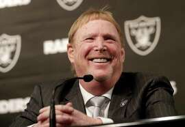 Oakland Raiders owner Mark Davis smiles at at a news conference introducing Mike Mayock as the team's general manager at the team's headquarters in Oakland, Calif., Monday, Dec. 31, 2018. (AP Photo/Jeff Chiu)