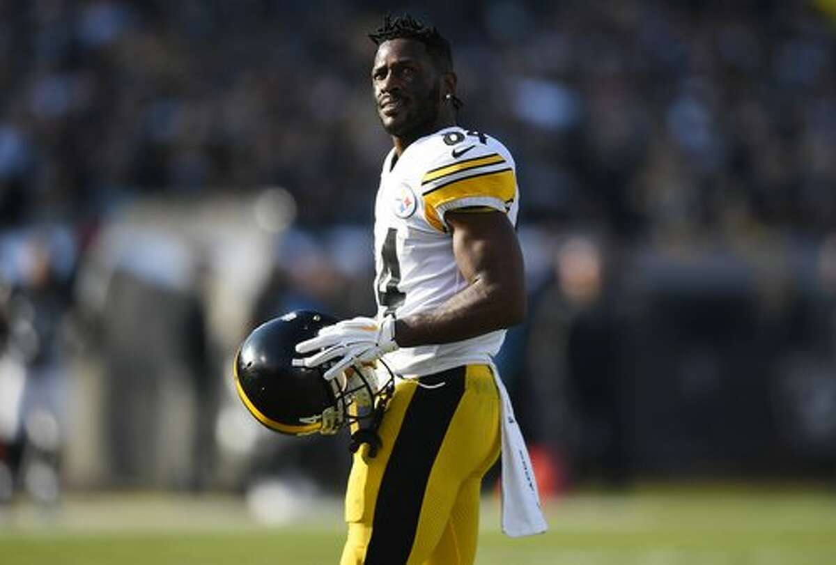 OAKLAND, CA - DECEMBER 09: Antonio Brown #84 of the Pittsburgh Steelers looks on as he walks onto the field against the Oakland Raiders during the first half of their NFL football game at Oakland-Alameda County Coliseum on December 9, 2018 in Oakland, Ca