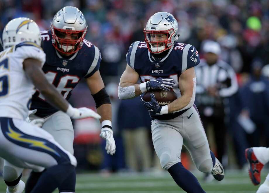 ca8c7394507 New England Patriots running back Rex Burkhead runs toward the goal line  for a touchdown against