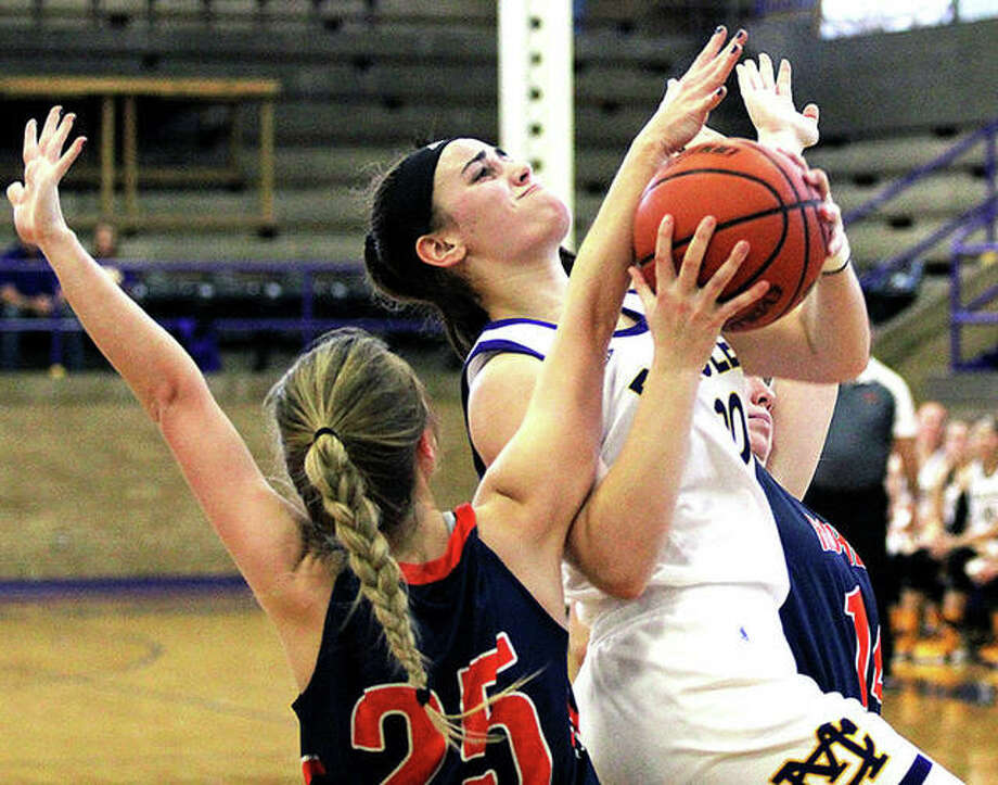 Anna Hall of Civic Memorial, right, scored 36 points and led the Eagles to a 75-34 victory over Salem Monday night in the first round of the Highland Tournament. She is shown in earlier action against Rochester. Photo: Telegraph File Photo