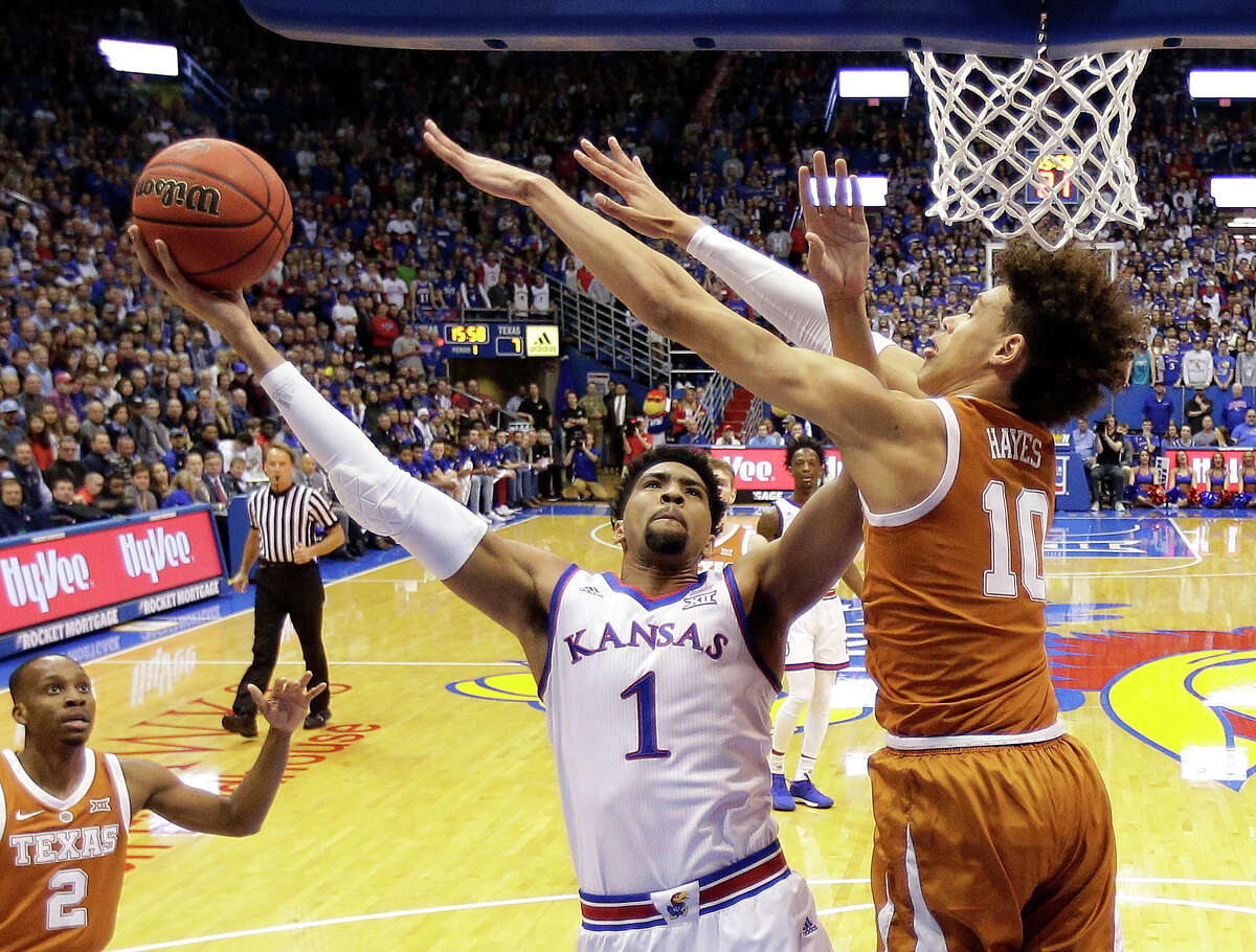 Kansas forward Dedric Lawson (1) shoots under pressure from Texas forward Jaxson Hayes (10) during the first half of an NCAA college basketball game Monday, Jan. 14, 2019, in Lawrence, Kan.