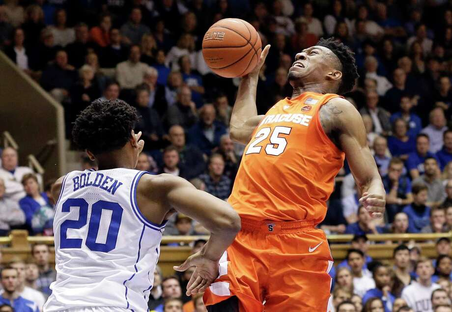 promo code 35004 0127d Duke s Marques Bolden (20) defends while Syracuse s Tyus Battle (25) drives  to