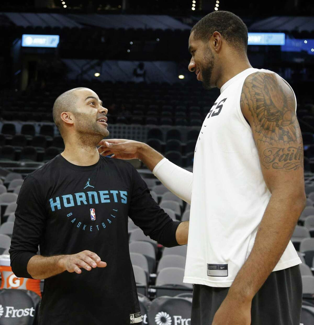 Tony Parker #9 of the Charlotte Hornets is greeted by LaMarcus Aldridge #12 of the San Antonio Spurs before the start of their game on Monday, January 14, 2019 at AT&T Center.