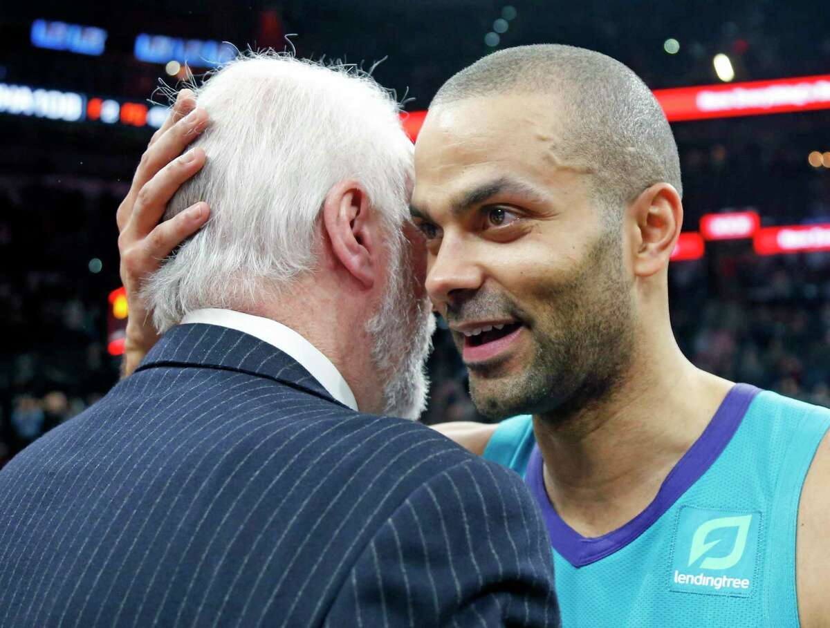 Tony Parker, returning to San Antonio as a member of the Charlotte Hornets, greets Spurs coach Greg Popovich at the end of the game Jan. 14, 2019 at AT&T Center.