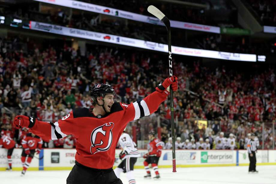 New Jersey Devils center Kevin Rooney celebrates after scoring his first career goal during the second period of an NHL hockey game against the Chicago Blackhawks, Monday, Jan. 14, 2019, in Newark, N.J. (AP Photo/Julio Cortez) Photo: Julio Cortez / Copyright 2019 The Associated Press. All rights reserved.