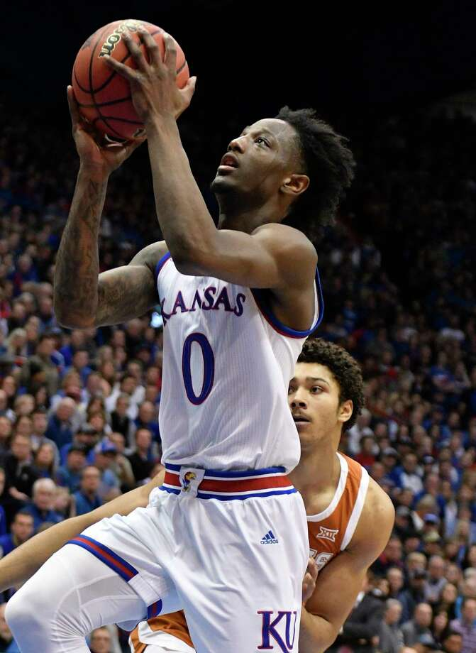 LAWRENCE, KANSAS - JANUARY 14: Marcus Garrett #0 of the Kansas Jayhawks lays the ball up against Jericho Sims #20 of the Texas Longhornsin the first half at Allen Fieldhouse on January 14, 2019 in Lawrence, Kansas. (Photo by Ed Zurga/Getty Images) Photo: Ed Zurga / 2019 Getty Images
