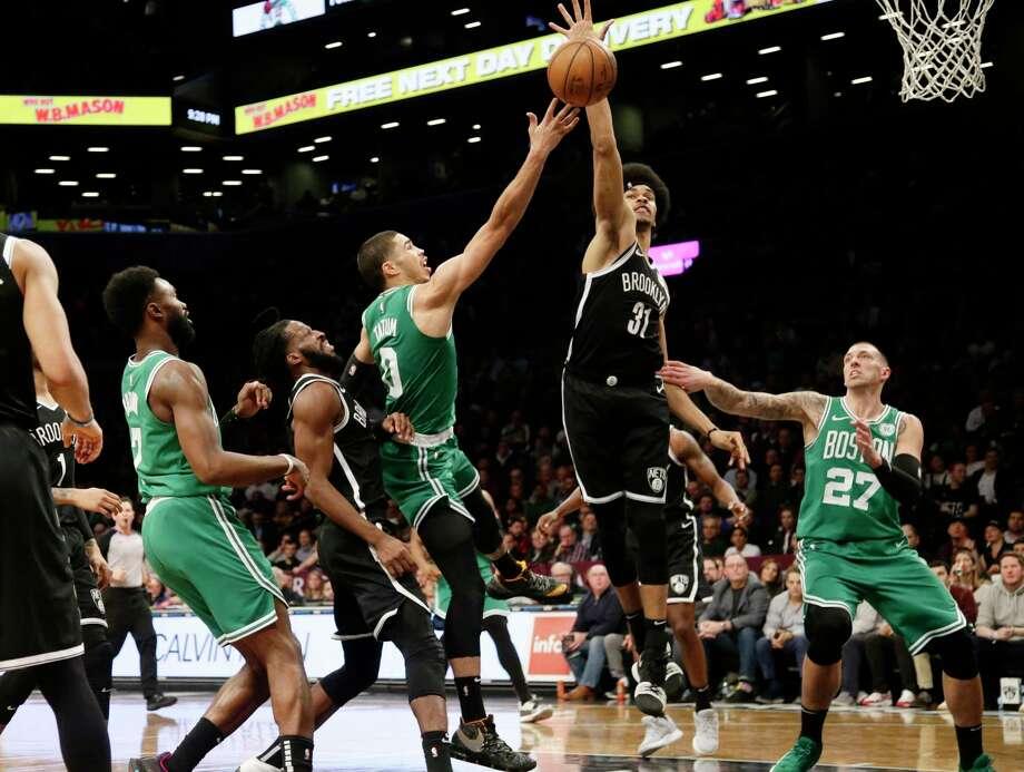 Brooklyn Nets' Jarrett Allen (31) blocks a shot by Boston Celtics' Jayson Tatum (0) during the second half of an NBA basketball game Monday, Jan. 14, 2019, in New York. The Nets won 109-102. (AP Photo/Frank Franklin II) Photo: Frank Franklin II / Copyright 2019 The Associated Press. All rights reserved.