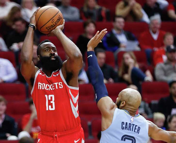 Houston Rockets guard James Harden (13) takes a shot over Memphis Grizzlies guard Jevon Carter (3) during the first half of an NBA basketball game at Toyota Center on Monday, Jan. 14, 2019, in Houston.