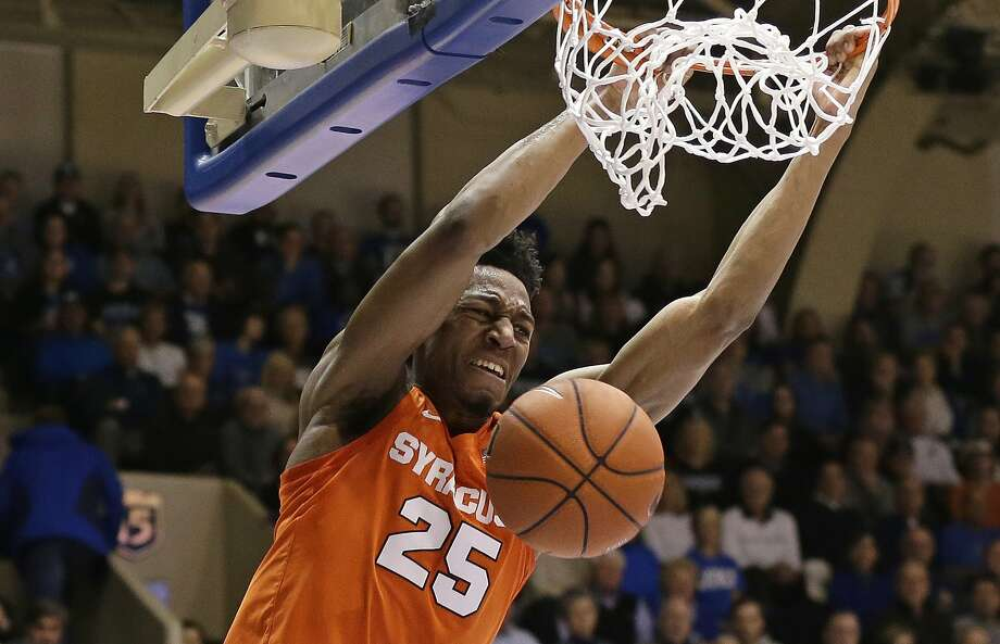 Syracuse's Tyus Battle (25) dunks against Duke during the first half of an NCAA college basketball game in Durham, N.C., Monday, Jan. 14, 2019. (AP Photo/Gerry Broome) Photo: Gerry Broome, Associated Press