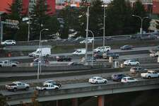 People drive on their evening commute home through downtown on the first work day since the Alaskan Way Viaduct was closed on Friday, Monday Jan. 11, 2018. Traffic was lighter than expected but may get worse before the new 99 tunnel is opened in February.