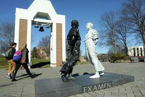 "The two-part sculpture of St. Ignatius is entitled ""Examen"" at the Egan Chapel of St. Ignatius Loyola plaza on Fairfield University's campus in Fairfield."