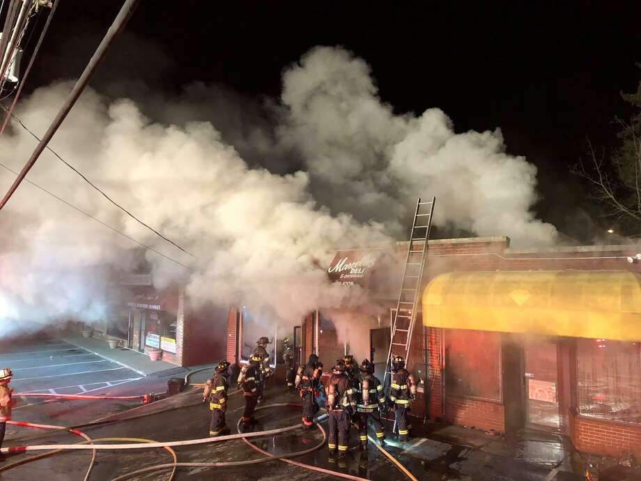 A three-alarm fire heavily damaged Marcello's Deli and Catering on Lake Avenue late Monday night. When firefighters arrived around 11:30 p.m. on Jan. 14, 2019, there was heavy smoke coming from a building near the corner of Lake Avenue and Hobson Street. Photo: Photo Credit: Danbury Fire Department And Rob Fish