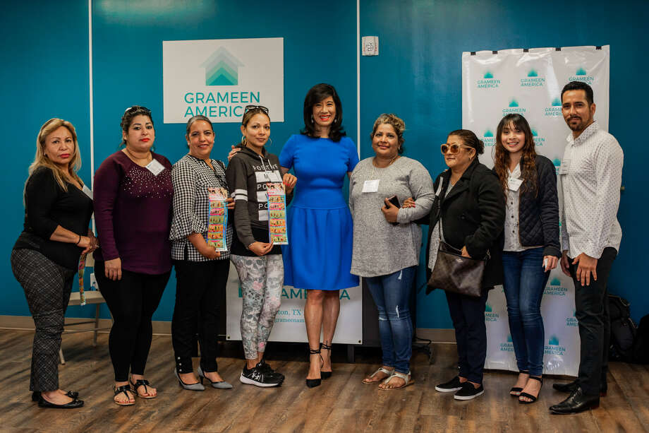 Grameen America President and CEO Andrea Jung, center, poses with staff members and some of the first Houston-area women entrepreneurs to receive microloans from the organization. Photo: Grameen America