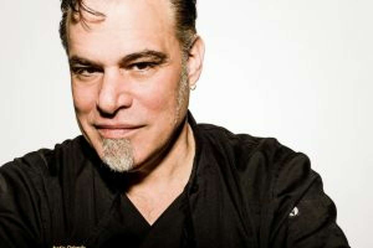Ric Orlando, who has cooked for the Wine & Dine for the Arts festival since the beginning, will be part of a virtual cooking show on April 17 that is part of the festival's reimagined programming. (File photo.)