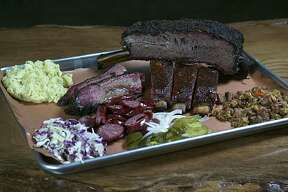 A plate of beef rib, prime brisket, jalapeño sausage, glazed pork ribs, cole slaw, potato salad and duck jambalaya at Pinkerton's Barbecue. The Houston-based barbecue restaurant has announced that it will be expanding into a second location in San Antonio.