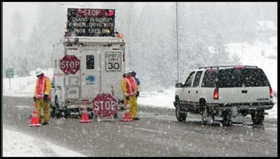 Caltrans crews monitor chain control over a Sierra Nevada highway. Photo: Caltrans