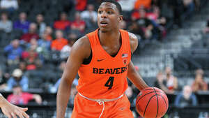 LLAS VEGAS, NV - MARCH 8: Oregon State forward Alfred Hollins (4) looks to make a pass during the quarterfinal game of the mens Pac-12 Tournament between the Oregon State Beavers and the USC Trojans on March 8, 2018, at the T-Mobile Arena in Las Vegas, NV. (Photo by Brian Rothmuller/Icon Sportswire via Getty Images)