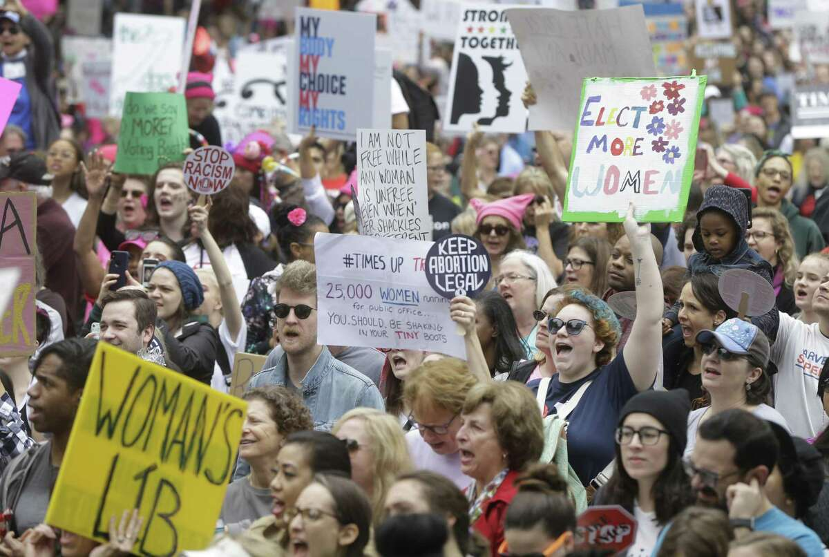 People rally at City Hall as part of the 2018 Houston Women's March. >>Check out the signs from the women's march in locations around the world last year...