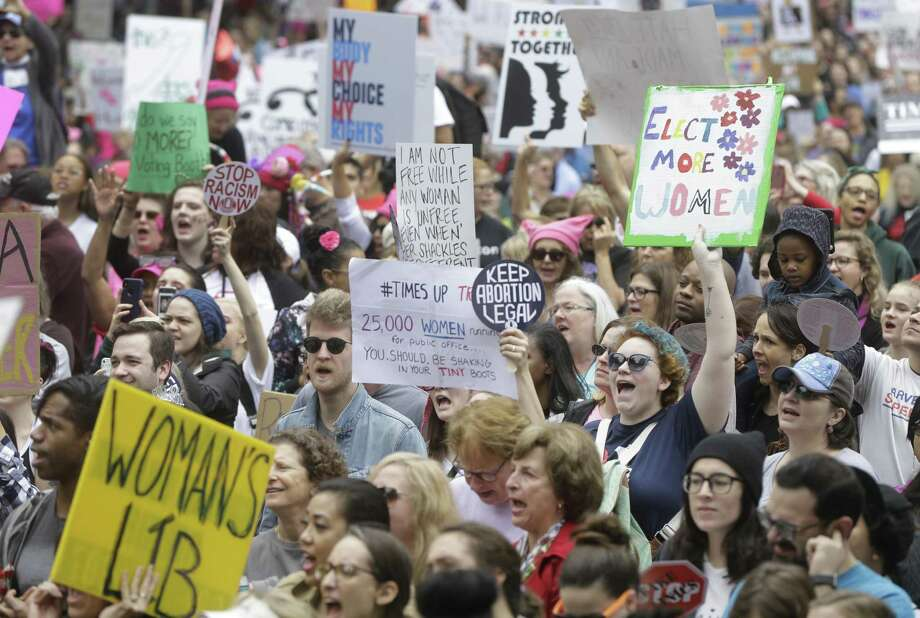 People rally at City Hall as part of the 2018 Houston Women's March. >>Check out the signs from the women's march in locations around the world last year... Photo: Melissa Phillip, Houston Chronicle / Houston Chronicle / © 2018 Houston Chronicle