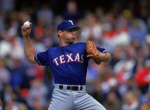 16 Apr 2000:  John Wetteland #35 of the Texas Rangers pitching during the game against the Cleveland Indians at Jacobs Field in Cleveland, Ohio. The Indians defeated the Rangers 2-1. Mandatory Credit: Harry How  /Allsport