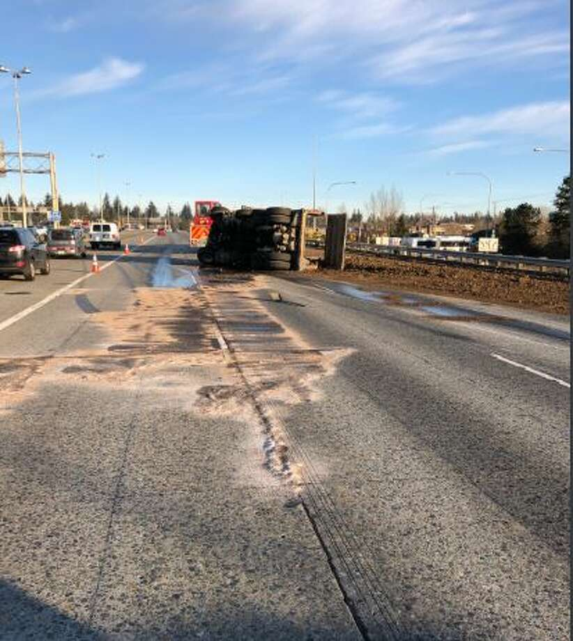 A dump truck overturned on northbound Interstate 5 near Northgate, blocking three lanes of traffic. Photo: Courtesy WSP