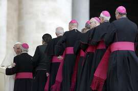FILE - In this April 18, 2018 file photo, bishops line up to greet Pope Francis during his weekly general audience in St. Peter's Basilica, at the Vatican. Catholic doctrine mandates an all-male priesthood, on the grounds that Jesus' apostles were men. A decades-long campaign for women's ordination has made little headway and some advocates of that change have been excommunicated. Women do play major roles in Catholic education, health care and parish administration. (AP Photo/Gregorio Borgia, File)