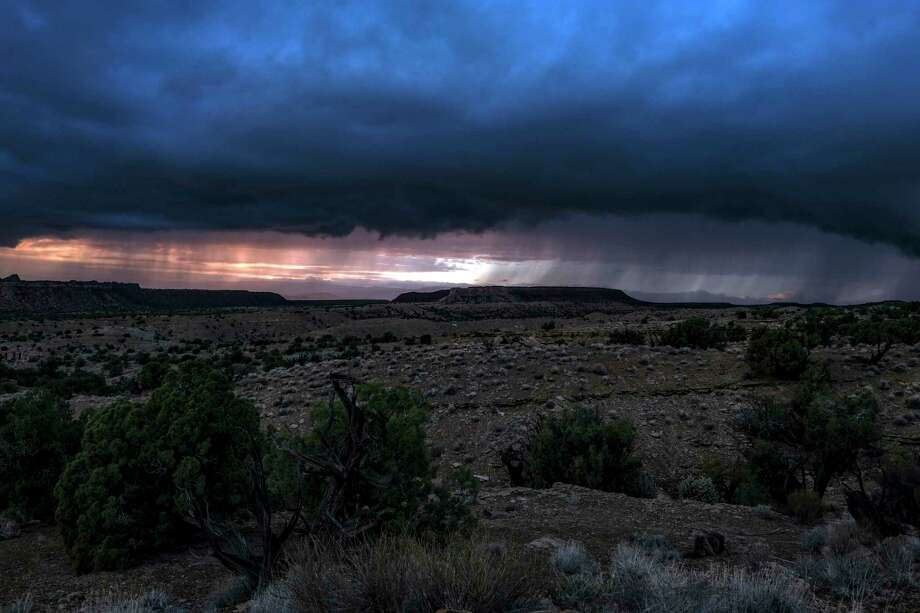 Cloud cover and rainfall in the Circle Cliffs region, an area removed from Grand Staircase - Escalante National Monument, in Garfield County, Utah on October 11, 2018. Photo: Washington Post Photo By Bonnie Jo Mount / The Washington Post